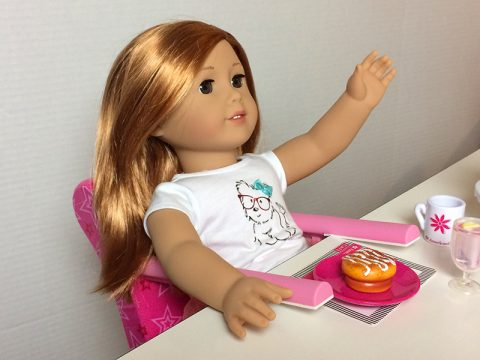 american-girl-doll-having-treat-in-seat